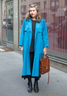 """Emilia, 20  """"I bought my coat for 1 euro at Fida thrift store. The skirt is from Indian Summer vintage store, the t-shirt and the shoes are my friend's.  I like to wear easy clothes. In autumn it's time to start putting on make-up again."""""""