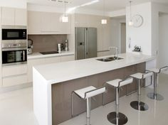 The Milano Bar Stool White looks stunning in this stylish and modern kitchen!