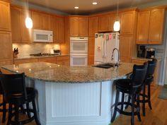 this kitchen received new hardware new granite countertops tile backsplash pendant lighting and santa ceciliagranite