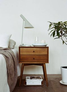 Vintage nightstand with beautiful Arne Jacobsen table lamp