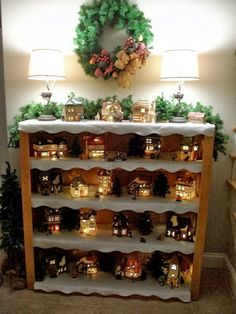 cordless Christmas village on a bookcase...This is a great way to display your favorite houses even if you don't have a lot of space.