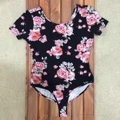 Forever 21 Floral Unitard  Size Large but definitely fits like a size Small. It's so pretty but I only got one use out of it because it no longer fits me. Forever 21 Tops