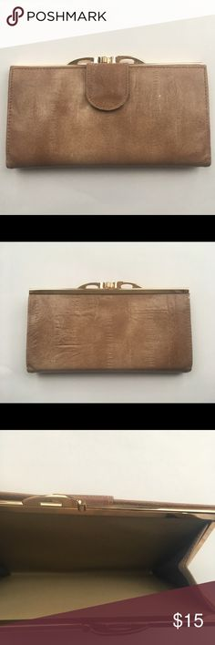 """Vintage Wallet Tan Kiss Clasp RARE Rare vintage kiss clasp wallet! Gorgeous faux eel skin exterior with gold hardware. Snap closure opens check book holder. 4 cars holders, 1 license holder, 2 pockets. Excellent condition! Dates to Late 1970s/Early-Mid 1980s.  Dimensions: Approx. 7.25"""" L x 3.75"""" H We will consider offers!  All sales are final, no returns or exchanges. Bags Wallets"""