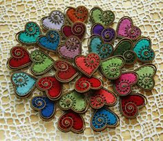 Wow - these are so pretty!  Tutorial for making a felt and zipper heart brooch PDF