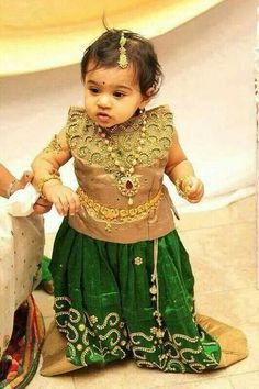 kanchi pattu langa blouse designs for baby. cute look for a baby. Kids Party Wear Dresses, Kids Dress Wear, Kids Gown, Dresses Kids Girl, Kids Wear, Kids Outfits, Baby Dresses, Baby Lehenga, Kids Lehenga