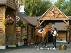 Inspiration for my barn - the hanging baskets are really pretty.