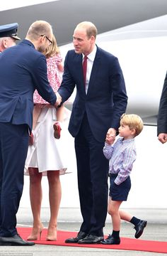 Prince George looked a little in awe as his father and mother were officially welcomed to ...