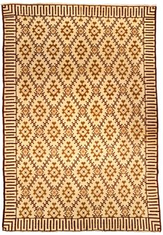 A Moroccan carpet BB4289 - A second quarter 20th century rug from Morocco, the maize field with an overall lozenge trellis with diamonds at ...