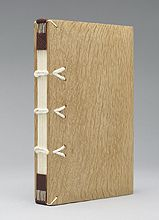 Model of a Carolingian binding, 7th-12th centuries AD  Handmade paper text block sewn double-flexible on cords  Wooden boards  Leather chemise with strap of Alum taw and bone peg