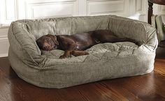 Orvis Lounger Deep Dish Dog Bed - for the 60-120# size this costs $199 - I would have to buy 2.  It's cheaper to buy them their own couch!