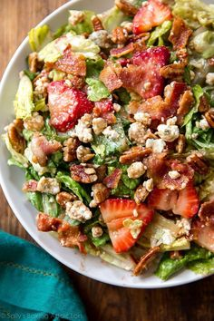 Perfect for warm weather, parties, lunch, and a light dinner! Sweet, savory, and simple strawberry bacon salad. Try adding grilled chicken! Recipe on sallysbakingaddiction.com