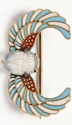 Egyptian Revival 14kt Gold, Carved Moonstone, and Enamel Brooch, designed as a winged scarab, lg. 1 1/8 in.