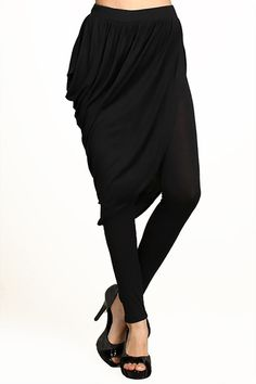 Looking for a stylish contemporary look?  Our Asymmetrical Draped Skirt Leggings feature a unique draped skirt attached to black leggings for a one of a kind style great for any occasion.  Pair these leggings with a blouse and pumps for a modern office look, or throw on a sexy top and wedges for a sleek and sexy clubwear style.  With so much style versatility our Asymmetrical Draped Skirt Leggings will become a fashion staple in your wardrobe.