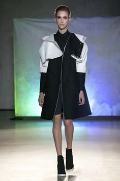 LOOK # 16  Cropped hooded coat, coat, 'shirt bib' accessory, shorts, perforated leather wedge boots