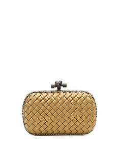 """Bottega Veneta satin clutch in signature intrecciato weave. Tonal ayers snake trims hard-shell body with rounded corners. Matte gunmetal hardware includes knotted hinge clasp. Satin lining. 4""""H x 7""""W"""