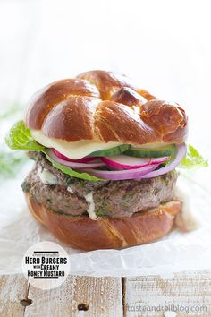 Cheese-Stuffed Herb Burgers with Creamy Honey Mustard - Boursin cheese is stuffed inside hamburger patties made with parsley, dill and chives, and then they are served with a creamy honey-mustard sauce. On Taste and Tell