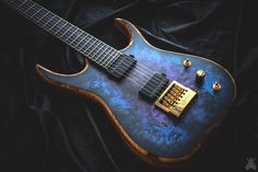 "Skervesen Raptor6. EverTune bridge, WDMod, BKPs and Hipshot locking tuners. Poplar burl top in ""Galaxy"" finish, mahogany body with figured rosewood back. Wenge-bubinga neck with ebony fretboard, abalone dots in ""tangent curve"", Viper headstock. Handmade ebony cavity covers."