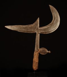 Africa    Ngbaka throwing knife, Democratic Republic of Congo.  Forged iron and fibre    late 19th to early 20th century.