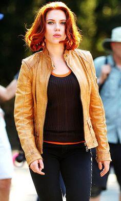 Black Widow Light brown leather jacket, Denim Jeans, Black over orange top.