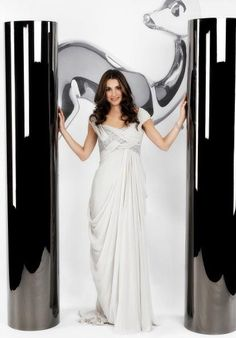 Queen Rania (Jordan) - White couture gown with silver details