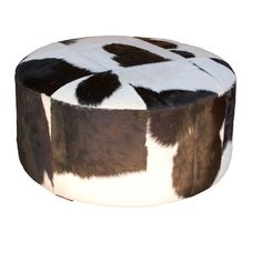 Round Hide Ottoman This Round Ottoman, upholstered in black and white cowhide, is a stylish option that is flexible enough to couple with a range of black and white furniture. Dimensions: Diameter x Height Ottoman Footstool, Round Ottoman, Ottomans, Armchairs, Black And White Furniture, Green Furniture, Bisque Interiors, Cow Hide, White Houses