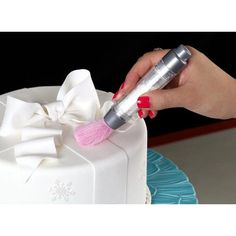 """If you use one special dust all the time (like super pearl), you will love this pump brush.  It will pay for itself over time because you'll use far less dust. In addition, you will gets much more even appearance to the cake, not """"splotchy"""". From Sweetwise.com"""