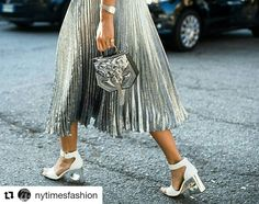 Gone in a flash: metallic silver skirt, bag and silver-heeled shoes passing by outside the shows. Silver Skirt, Metallic Skirt, Metallic Bag, Milan Fashion Week Street Style, Street Style Shoes, Paris Fashion, High Fashion, Parisian Chic Style, Fairytale Fashion