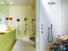 flowers painted on wall tiles in bathroom