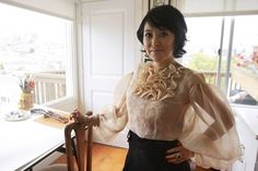 Love this sheer poet shirt sleeve on Artist Colleen Quen.... in her home studio in North Beach, where she paints. Photo: Craig Hudson, The San Francisco Chronicle (Ms Quen has a long history as a gown designer)