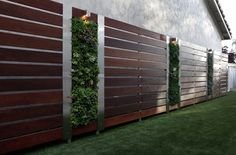 Well Organized Garden Landscape by Building Garden Fences : Beautiful Garden Fences With Ipe Deck Boards And Aluminum Posts Also Stainless Steel Panels With Vertical Module And Succulents Plus Outdoor Led Lighting