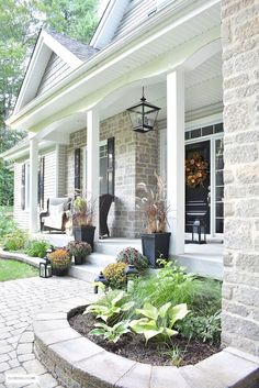 Outdoor Decorating/Gardening : A simple and elegant front porch decorated for Fall with seasonal flowers in autumnal colors, and a sophisticated overscale wreath for the front door. Sidewalk Landscaping, Landscaping Ideas, Front Door Landscaping, Brick Sidewalk, Veranda Design, Porch Kits, Porch Ideas, Farmhouse Front Porches, Casa Patio