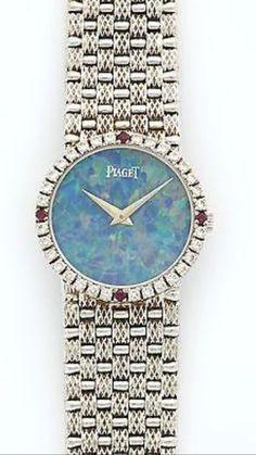 Vintage PIAGET White Gold Opal Diamond Ruby Bracelet Watch. #womenswhitegoldbracelets