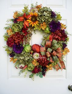 Tuscan wreath with artichokes and grapes. http://www.timelessfloralcreations.com/ https://www.facebook.com/timelesswreaths