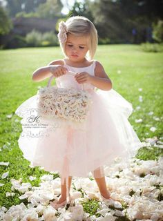 Karen Tran does such adorable flower girl bags made out of... flowers! #weddings  #NJBride and #NJBridePin2Win