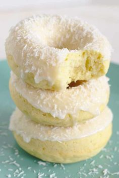 Baked Coconut Donuts - This baked donut recipe is perfect for breakfast or brunch this weekend! Coconut cake donuts baked in a donut pan and topped with a coconut icing and shredded coconut. This coconut donut recipe is perfect for coconut fans! Baked Donut Recipes, Baked Doughnuts, Baking Recipes, Cake Recipes, Dessert Recipes, Fried Donuts, Donuts Donuts, Cake Donut Recipe Baked, Donut Muffins