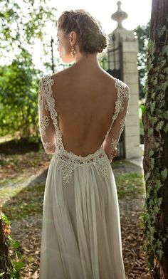 Your wedding is the perfect occasion or a dramatic open-back dress.