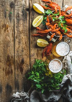 Wheat beer and boiled crayfish over old wooden rustic background by sonyakamoz. Two pints of wheat beer and boiled crayfish with lemon and parsley over old wooden rustic background, top view, copy . Beer Background, Rustic Background, Porterhouse, Wheat Beer, Pub, Beer Humor, Blog Images, Antipasto, Food Photo
