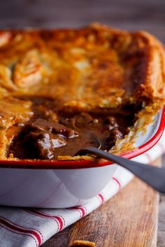 Rich, meaty steak and mushroom stew topped with golden, flaky pastry. This steak and mushroom pot pie is the personification of comfort food. Steak And Mushroom Pie, Steak And Mushrooms, Stuffed Mushrooms, Mushroom Stew, Wild Mushrooms, Mini Pot Pies, Beef Pot Pies, Pie Recipes, Casserole Recipes