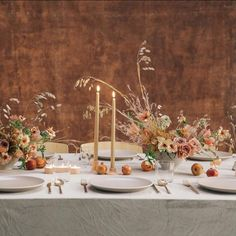 "This table is my take on ""blush"". Ok, it's a bit of a stretch 🤣. But I guess that's the point! minimalist tablescape by Sarah Winward for If I Made course, pomegranates, cappucino roses, butterfly ranunculus, and grasses with tall taper candles, and gold flatware. #fallwedding #tablescape #blushflowers"