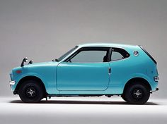 HONDA Z360- we had one when I was in H.S. the thing could be picked up by 3 or 4 guys. Hell the wheels were the siz e of a riding lawnmower but it got 50 plus mpg. and that was '71' or '72'