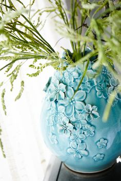 This Pier 1 Blossoms Aqua Vase doesn't need blooms since it's already covered with beautiful, sculpted blossoms. But it looks great filled with colorful faux flowers or dried grasses, too.