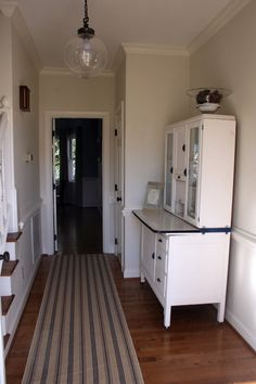 Walls are Pittsburgh Paints 'Colonial White'. Trim is Sherwin Williams 'Westhighland White'.