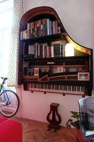 Recycled old broken piano- bookshelf. perhaps a previously loved one from a second hand shop or estate/garage sale