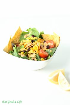 vegetarian taco salad  6 oz fresh baby kale or spinach  6 oz corn tortillas, gluten free  14 oz canned black beans  8 oz sweet corn  5 oz cherry tomatoes, sliced  4 oz sharp cheddar cheese, grated  Dressing  1 cup Greek Yogurt  1 tbsp McCormick Taco Seasoning Mix  1 lemon, juice  2 tbsp balsamic vinegar  2 tbsp extra virgin olive oil  2 tbsp water  1/2 tsp Himalayan salt