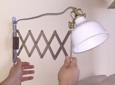 Materials: FRÄCK mirror, RANARP wall/clamp spotlight Seems there are several scissor lamps out there that cost an arm and a leg; the average price being around $160. I found a few hacks using the FRÄC