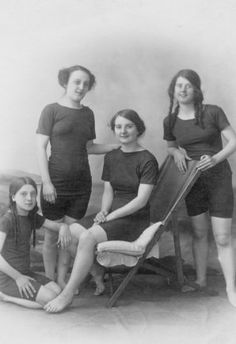 """Our Berwick girls at the beach? """"Bathers"""" wore tunics over bathing drawers. Anchor motifs and taped edges gave a nautical look. This style persisted into the early 1920s. At the Seaside emphasis was gradually shifting from Sea-bathing to swimming. Sunbathing was many years away.  Many people still did not own their own bathing costumes and it is difficult to judge the date of hired costumes. Younger women who took swimming seriously donned knee length one piece knitted garments."""