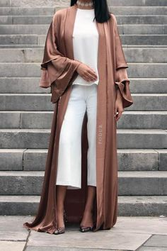 Lightweight front open Kimono/Abaya made from soft crepe (Linen) with beautiful bronze detailing running down the front, compliments many Abayas and outfits and adds a touch of luxe to an evening ensemble.  Also Available in Rose Gold  Frilled style sleeves Can be worn as open as a kimono  Hijab Included