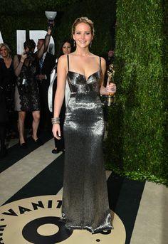 Louisville, KY  #JenniferLawrence wears a metallic #calvinklein dress at the Vanity Fair #oscars party.