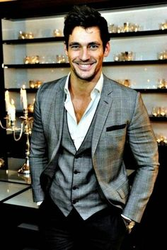 Shop this look on Lookastic: https://lookastic.com/men/looks/blazer-waistcoat-dress-shirt-dress-pants-pocket-square/607 — Grey Plaid Blazer — Grey Plaid Waistcoat — Black Pocket Square — White Dress Shirt — Black Dress Pants