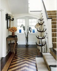 We love the painterly floor design in this shot. – Design Inspiration From a Mansion Makeover chevron painted floor subtle summer colors Painted Wood Floors, Wooden Flooring, Flooring Ideas, Painted Rug, Hardwood Floors, Entryway Flooring, Plywood Floors, Unique Flooring, Laminate Flooring
